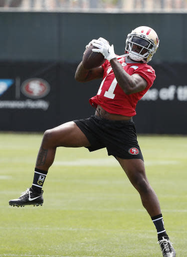 San Francisco 49ers wide receiver Marquise Goodwin makes a catch during practice at the NFL football team's training camp in Santa Clara, Calif., on Tuesday, May 22, 2018. (AP Photo/Tony Avelar)