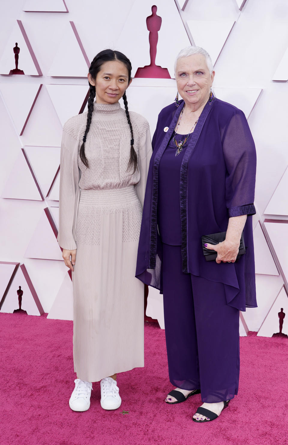 Chloe Zhao, left, and Charlene Swankie arrive at the Oscars on Sunday, April 25, 2021, at Union Station in Los Angeles. (AP Photo/Chris Pizzello, Pool)