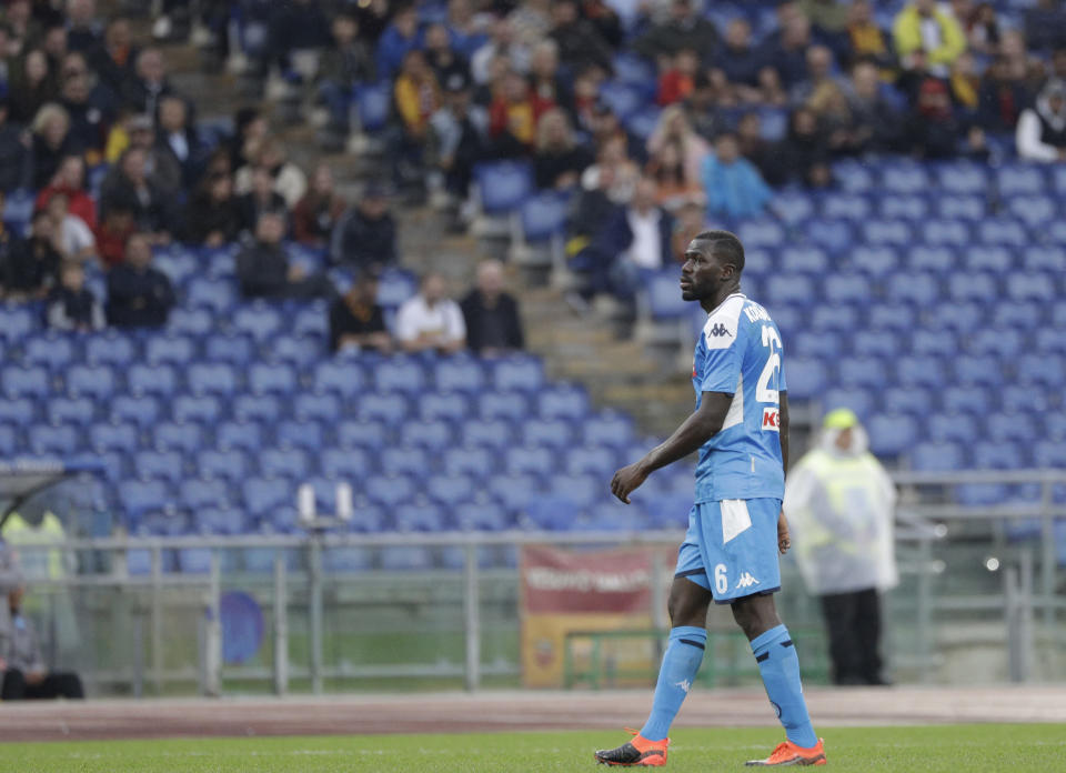 Napoli's Kalidou Koulibaly walks the pitch as the match was briefly suspended because fans were making racist chants against him, during an Italian Serie A soccer match between Roma and Napoli, at the Olympic stadium in Rome, Saturday, Nov. 2, 2019. (AP Photo/Gregorio Borgia)