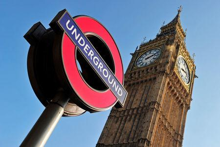 FILE PHOTO:  The Westminster Station London Underground sign is seen near The Houses of Parliament in London