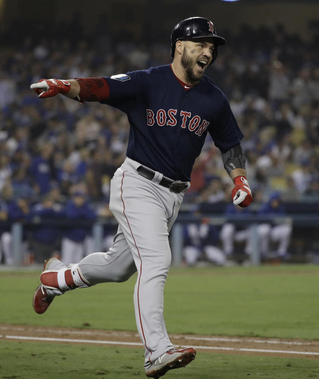 Boston Red Sox's Steve Pearce celebrates his second home run during the eighth inning in Game 5 of the World Series baseball game against the Los Angeles Dodgers on Sunday, Oct. 28, 2018, in Los Angeles. (AP Photo/David J. Phillip)