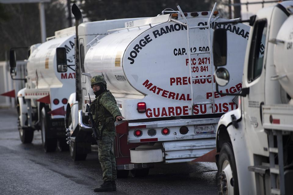 A Mexican soldier guards the entrance to an oil refinery of Mexico's oil company PEMEX, where private tanker trucks are being supplied with fuel, in Tula, Hidalgo state, Mexico, on January 11, 2018. - President Andres Manuel Lopez Obrador urged Mexicans not to panic as gasoline shortages spread across the country, caused by a crackdown on fuel theft that risks backfiring badly. The president says the shortages were triggered by his administration's decision to temporarily close some of state oil company Pemex's pipelines -- part of his bid to wipe out rampant fuel theft that cost the country an estimated $3 billion in 2017. (Photo by Pedro PARDO / AFP)        (Photo credit should read PEDRO PARDO/AFP via Getty Images)