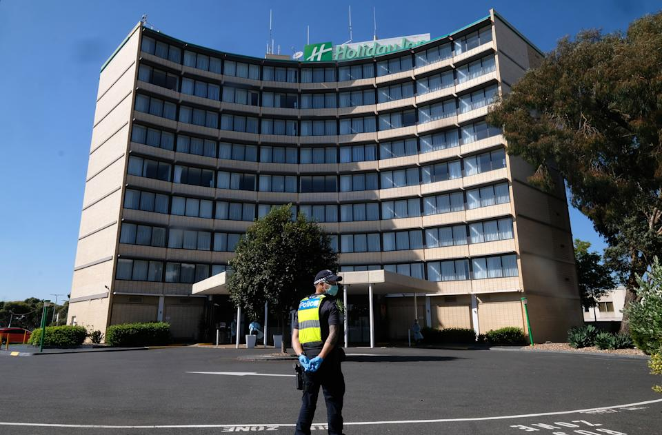Quarantining hotel guest at the Holiday Inn near the  Airport are moved to a new location in Melbourne. Source: AAP