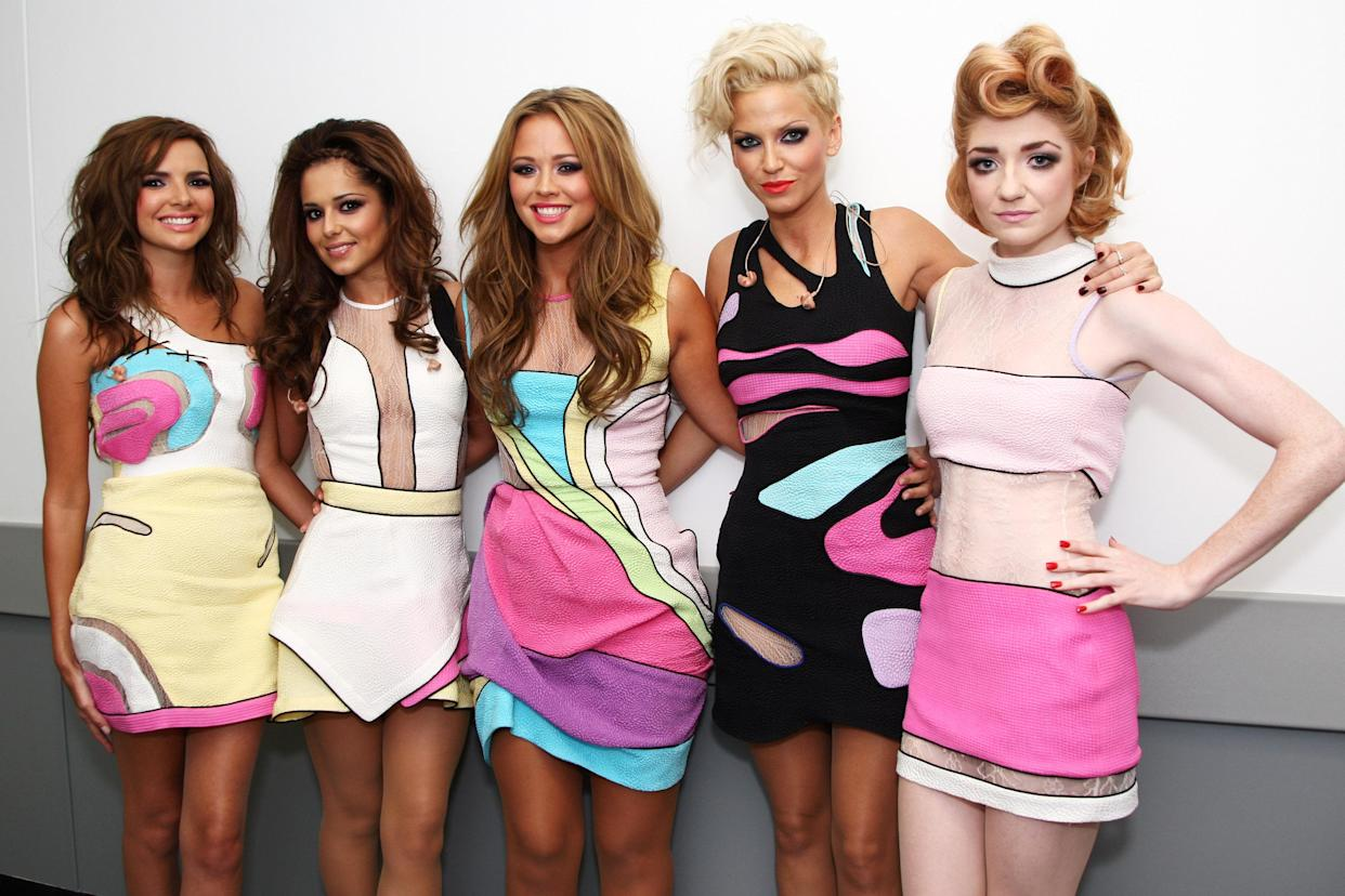 LONDON, ENGLAND - SEPTEMBER 19: L-R Nadine Coyle, Cheryl Cole, Kimberley Walsh, Sarah Harding and Nicola Roberts of Girls Aloud pose backstage at Wembley Stadium before performing as part of Coldplay's Viva La Vida tour at Wembley Stadium on September 19, 2009 in London, England. (Photo by Dave Hogan/Girls Aloud/Getty Images)