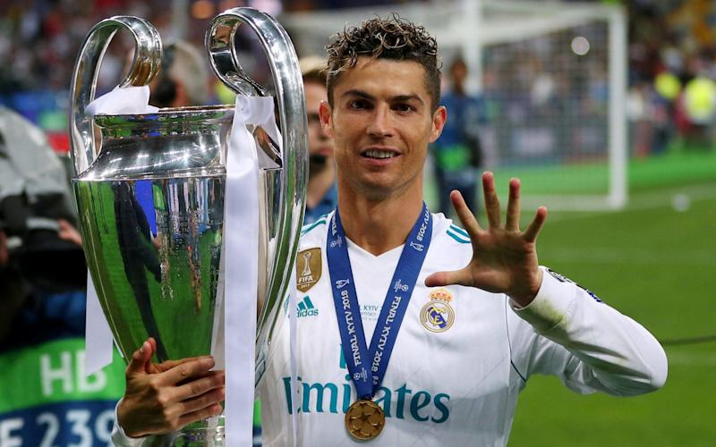 Real Madrid's Cristiano Ronaldo gestures as he celebrates winning the Champions League - REUTERS