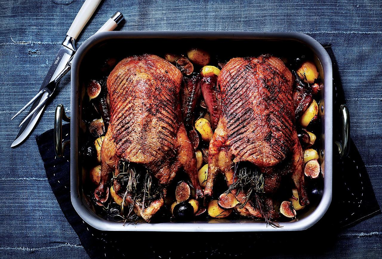 """When making this roast duck recipe, don't forget to save all that precious rendered duck fat. <a href=""""https://www.bonappetit.com/recipe/roast-ducks-potatoes-figs-rosemary?mbid=synd_yahoo_rss"""">See recipe.</a>"""