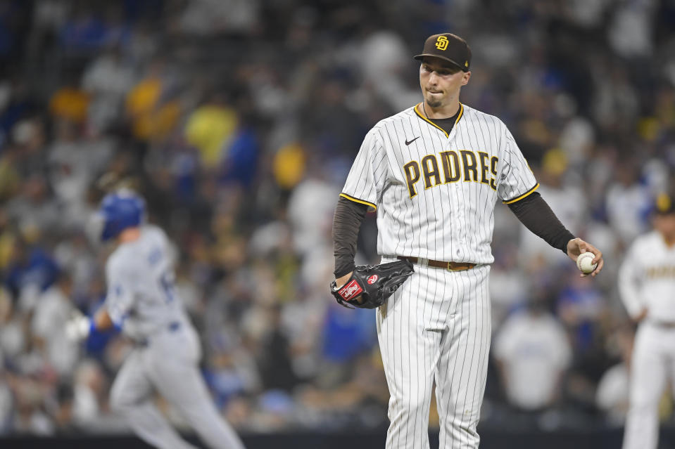 Blake Snell of the San Diego Padres stands on the mound after giving up a solo home run to Dodgers catcher Will Smith. (Photo by Denis Poroy/Getty Images)