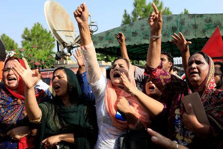 Supporters of former Prime Minister Nawaz Sharif react as they celebrate following the court's decision in Islamabad, Pakistan September 19, 2018.  REUTERS/Faisal Mahmood