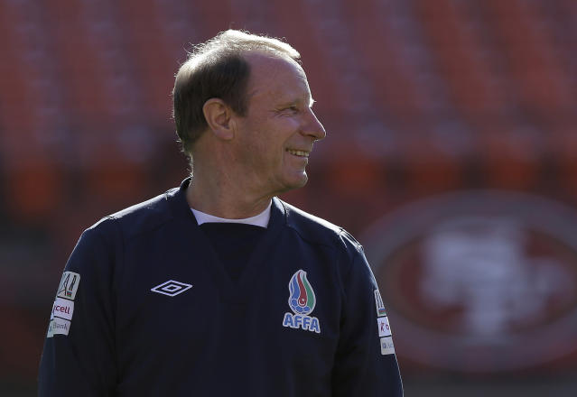 Azerbaijan soccer head coach Berti Vogts smiles as his team begins practice at Candlestick Park in San Francisco, Sunday, May 25, 2014. (AP Photo/Jeff Chiu)