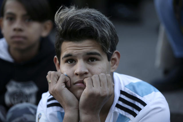 Argentina watches in disbelief at the end of a televised broadcast of the Croatia vs. Argentina World Cup soccer match, in Buenos Aires, Argentina, Thursday, June 21, 2018. Argentina lost 3-0 to Croatia. (AP Photo Jorge Saenz)