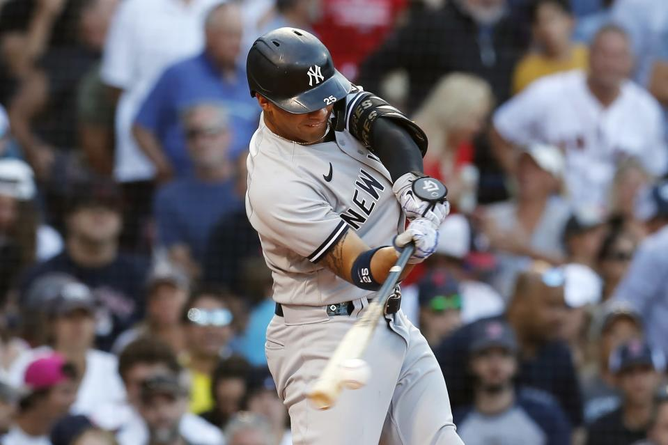 New York Yankees' Gleyber Torres hits an RBI-single during the eighth inning of a baseball game against the Boston Red Sox, Saturday, July 24, 2021, in Boston. (AP Photo/Michael Dwyer)