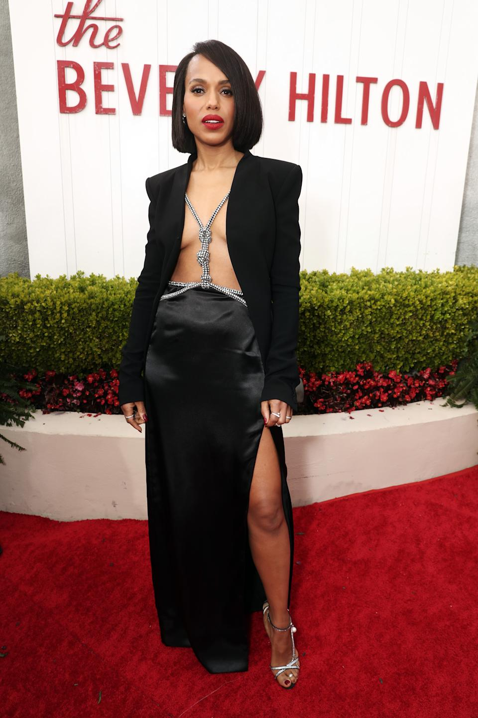 Washington made jaws drop as she arrived on the red carpet in an open blazer, and black skirt with a high-high slit. (Photo by: Todd Williamson/NBC/NBCU Photo Bank via Getty Images)