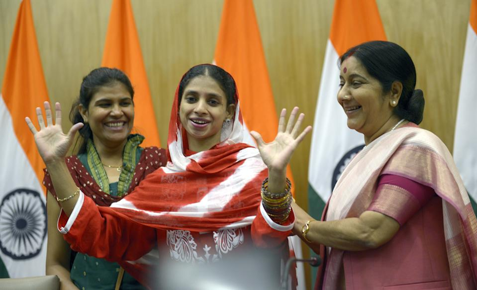 'Geeta' is embraced by Sushma Swaraj after a press conference in New Delhi on October 26, 2015. (Photo by Yasbant Negi/The India Today Group via Getty Images)