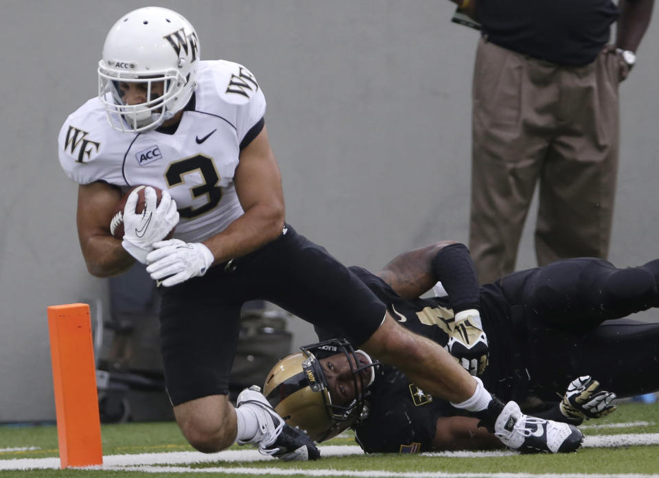 Wake Forest wide receiver Michael Campanaro (3) scores in front of Army's Chris Carnegie after a pass reception during the first half of an NCAA college football game on Saturday, Sept. 21, 2013, in West Point, N.Y. (AP Photo/Mike Groll)