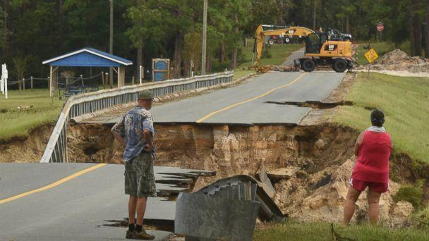 PHOTO: Mary and Phil Pongonis look at the damaged roadway from Hurricane Florence in Boiling Spring Lakes, N.C., Sept. 18, 2018. (Ken Blevins/The Star-News/AP)