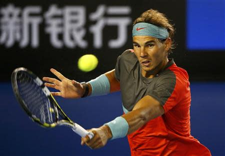 Rafael Nadal of Spain hits a return to Stanislas Wawrinka of Switzerland during their men's singles final match at the Australian Open 2014 tennis tournament in Melbourne January 26, 2014. REUTERS/Petar Kujundzic