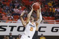 Oklahoma State guard Lindy Waters III (21) shoots in front of Wichita State forward Isaiah Poor Bear-Chandler, rear, in the first half of an NCAA college basketball game in Stillwater, Okla., Sunday, Dec. 8, 2019. (AP Photo/Sue Ogrocki)