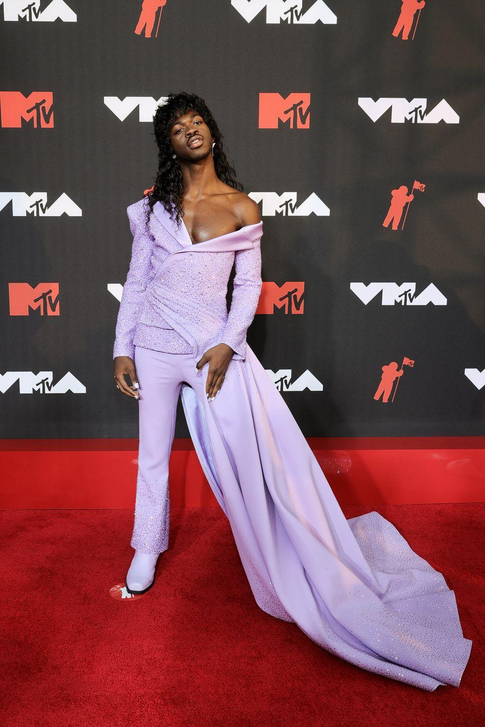 <p>Lis Nas X made a memorable entrance on the carpet in a lavender two-piece set with an off-the-shoulder top and statement train. He paired the look with a mullet hairstyle. </p>