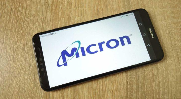 Micron (MU) logo on a mobile phone that's on a table