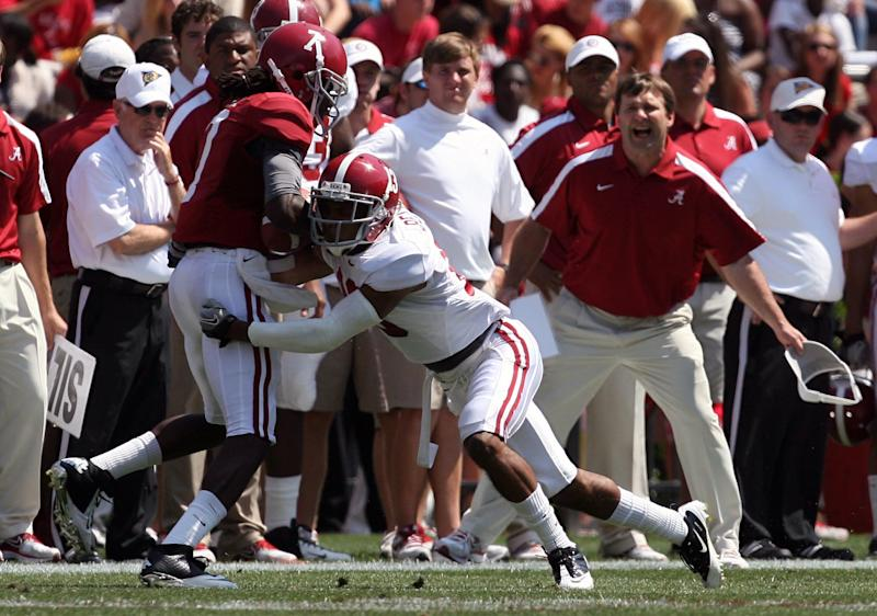 Crimson team wide receiver Kenny Bell (7) is tackled by White team defensive back Deion Belue (13) during the first half of the A-Day game at Bryant-Denny Stadium in Tuscaloosa, Ala. Saturday, April 14, 2012. (AP Photo/Tuscaloosa News, Michelle Lepianka Carter)