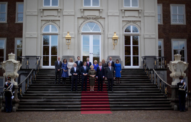 Dutch Queen Beatrix, center, Prime Minister Mark Rutte, center left, Deputy Prime Minister and Minister of Social Affairs and Employment Lodewijk Asscher, center right, pose with other ministers of the new Dutch government on the steps of Royal palace Huis Ten Bosch after their inauguration ceremony in The Hague, Netherlands, Monday Nov. 5, 2012. (AP Photo/Peter Dejong)