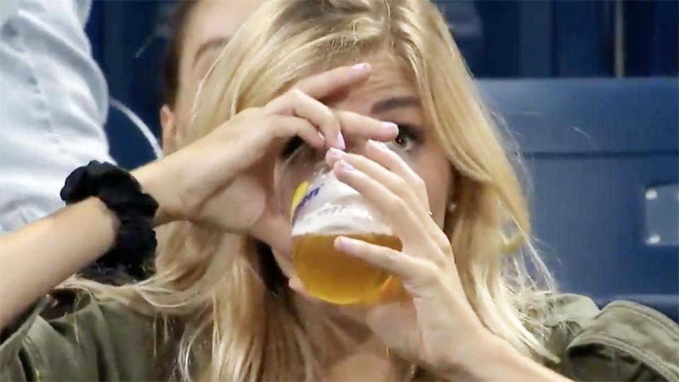 The US Open fan, pictured here repeating her feat by downing a second beer.
