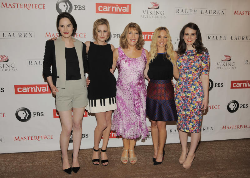 """Left to right, Michelle Dockery, Laura Carmichael, Phyllis Logan, Joanne Froggatt and Sophie McShera, cast members in the Masterpiece series """"Downton Abbey,"""" pose together at the PBS Summer 2013 TCA press tour at the Beverly Hilton Hotel on Tuesday, Aug. 6, 2013 in Beverly Hills, Calif. (Photo by Chris Pizzello/Invision/AP)"""