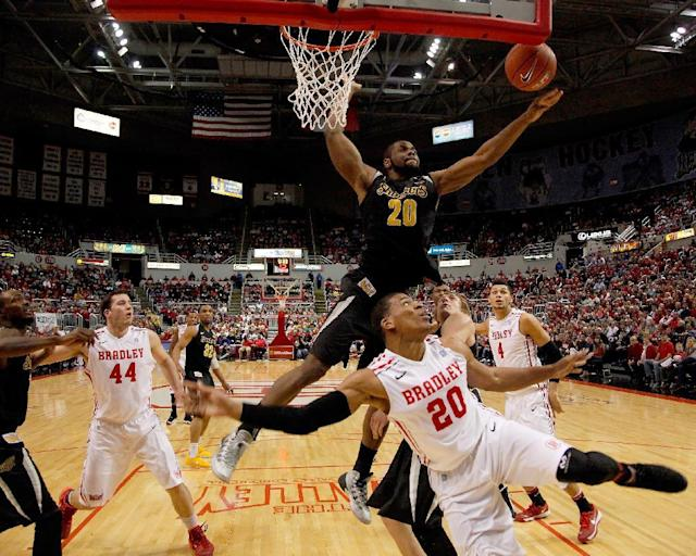 Wichita State center Kadeem Coleby (20) blocks a layup from Bradley forward Tyshon Pickett (20) during the first half of an NCAA college basketball game at Carver Arena Tuesday, Feb. 25, 2014, in Peoria, Ill. Wichita State won the game 69-49. (AP Photo/ Stephen Haas)
