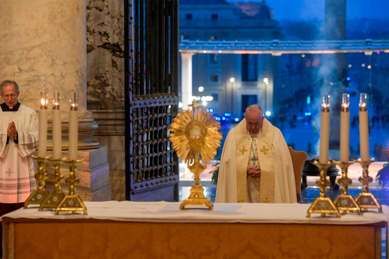 Pope Francis prepares to give the Urbi et orbi blessing after presiding over a moment of prayer on the sagrato of St Peter's Basilica, the platform at the top of the steps immediately in front of the facade of the church.