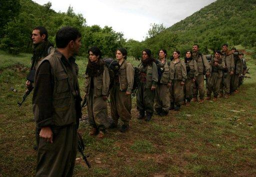 PKK fighters arrive in the northern Iraqi city of Dohuk on May 14, 2013, after leaving Turkey as part of a peace drive