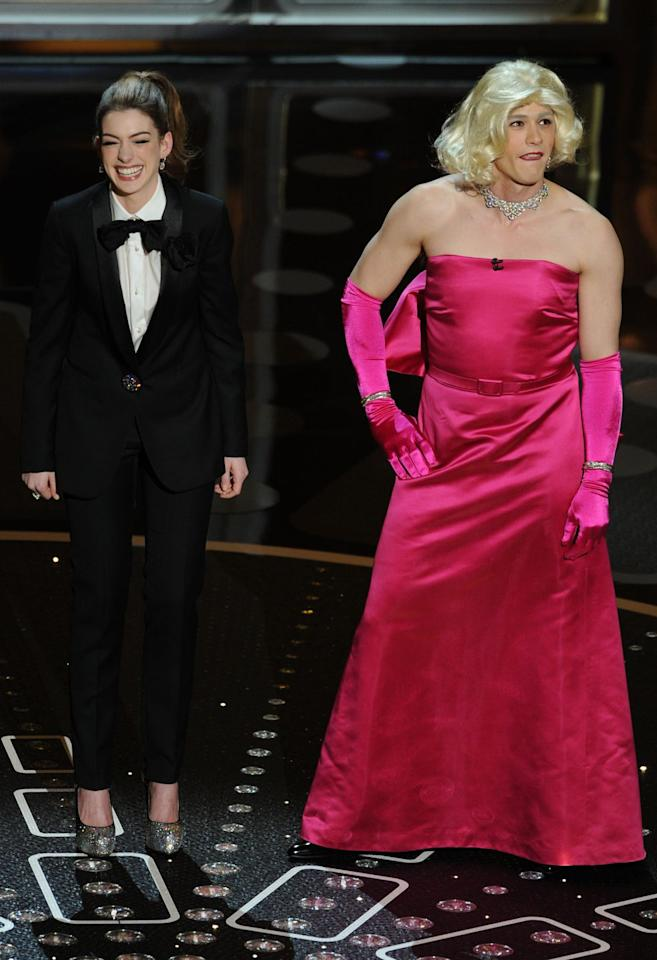 "<p>In reversed gender roles, Franco wore a satin pink gown and Hathaway wore a tuxedo to host the 2011 Oscars. Despite their attempted comedic act, <a rel=""nofollow"" href=""https://www.hollywoodreporter.com/news/oscar-reviews-what-critics-thought-162253"">people weren't impressed</a> and even referred to it as ""one of the worst Oscar telecasts in history."" Many critics pointed out that Hathaway seemed to be trying too hard while Franco wasn't trying hard enough.</p>"