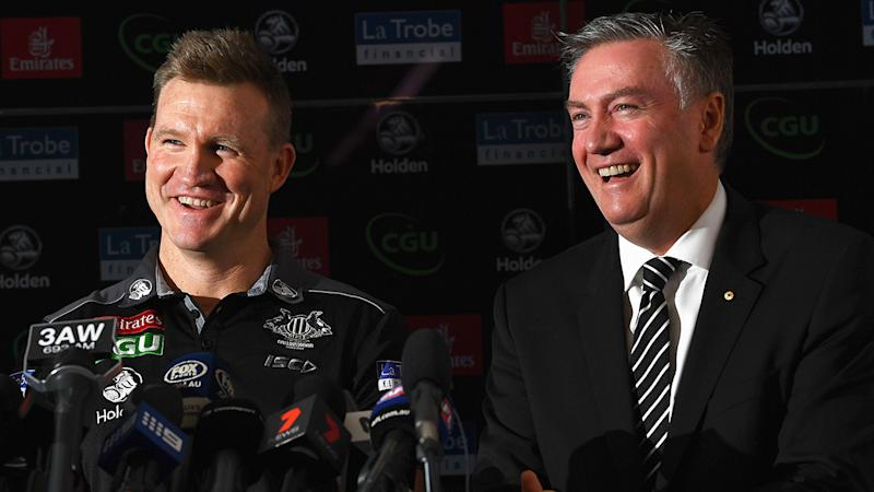 Nathan Buckley and Eddie McGuire are pictured laughing during a press conference.