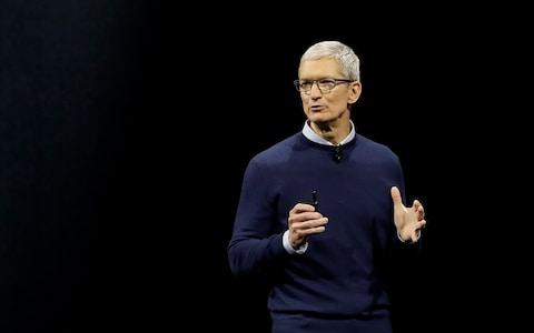 Tim Cook, Apple's chief executive, apologies to users just after the app's launch in 2012 - Credit: AP