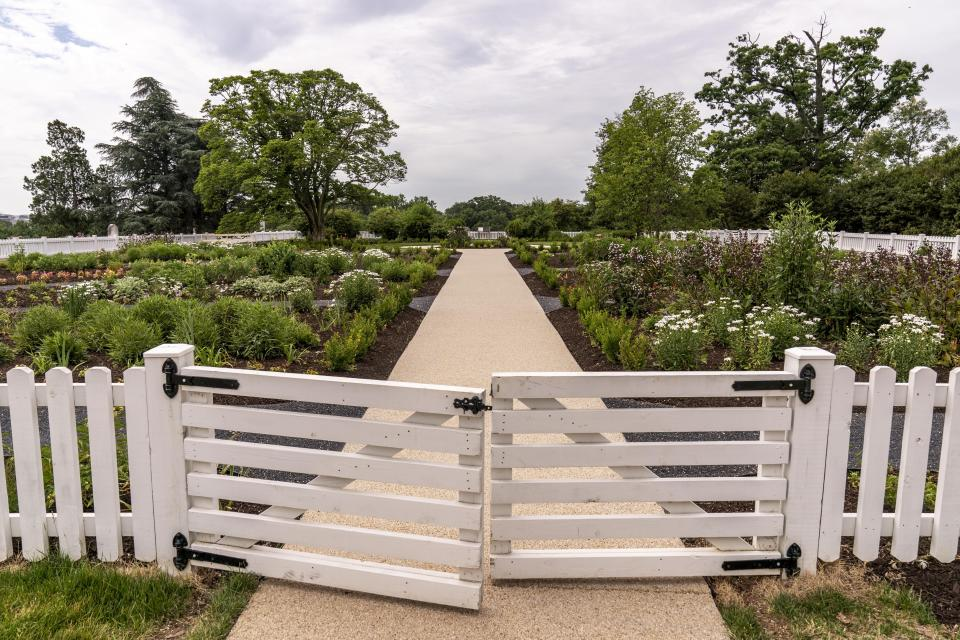 The flower garden at Arlington House, The Robert E. Lee Memorial, formerly named the Custis-Lee Mansion, reopens to the public for the first time since 2018 at Arlington National Cemetery, Tuesday, June 8, 2021 in Arlington, Va. The Virginia mansion where Robert E. Lee once lived that now overlooks Arlington National Cemetery is open to the public again, after a $12 million rehabilitation and reinterpretation that includes an increased emphasis on those who were enslaved there. (AP Photo/Andrew Harnik)