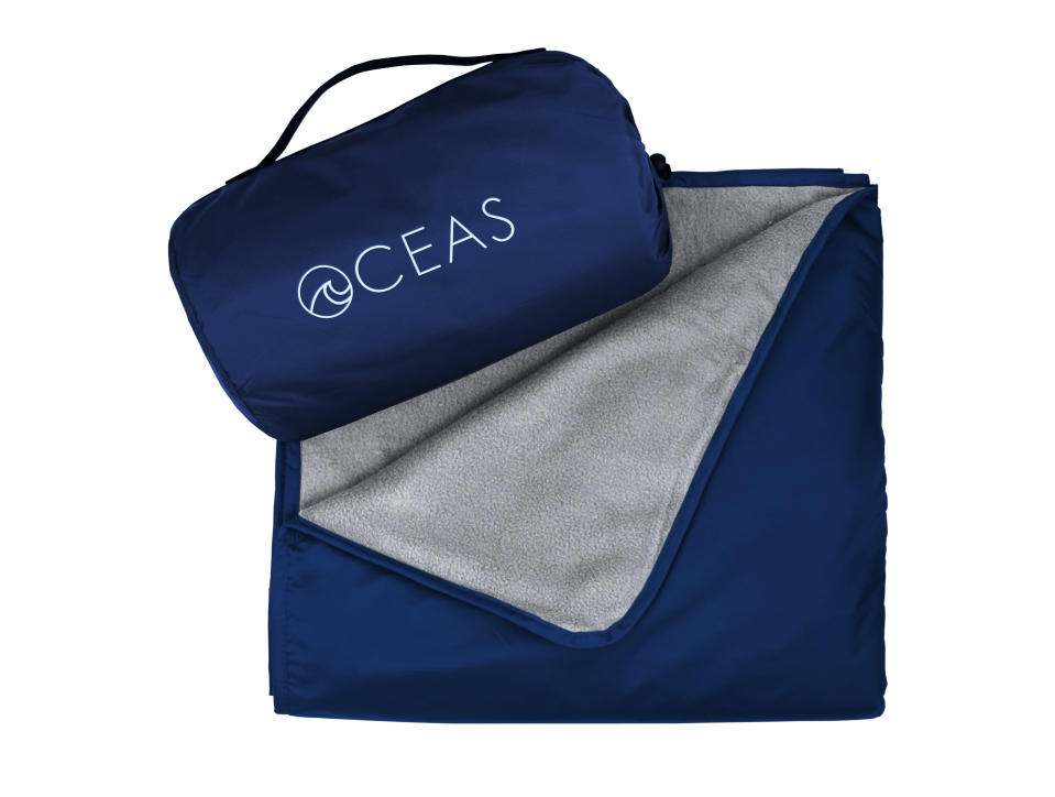 This image shows the Oceas Waterproof Blanket that comes with a carry pouch. (Oceas via AP)
