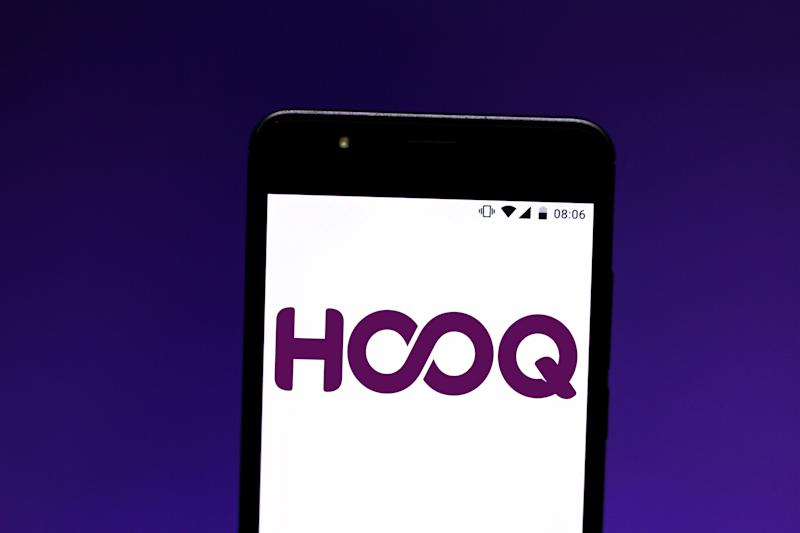 In this photo illustration a HOOQ logo seen displayed on a
