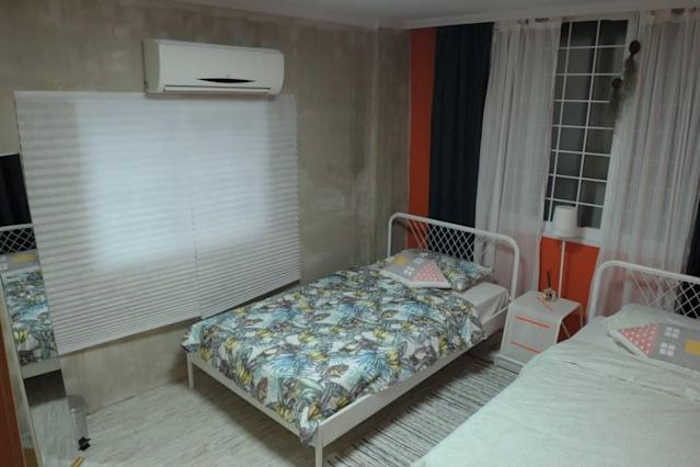 <p>The second bedroom has separate beds. (Airbnb) </p>