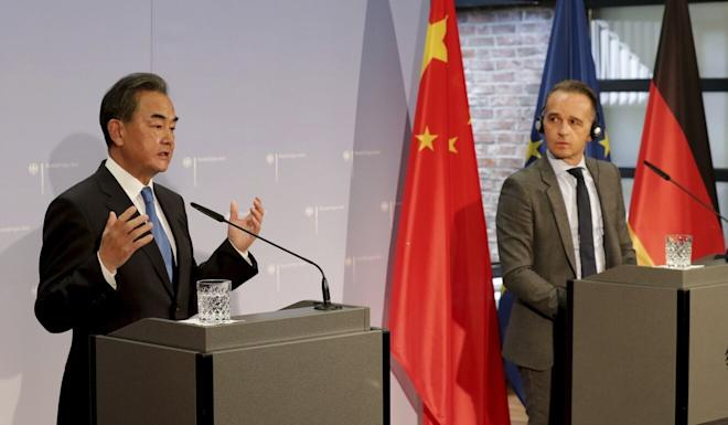 Chinese Foreign Minister Wang Yi speaks during a press conference with German Foreign Minister Heiko Maas following their meeting on Tuesday. Photo: AP via dpa