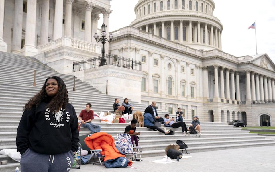 Representative Cori Bush, a Democrat from Missouri, left, joined by Congressional staffers and activists, protests the expiration of the eviction moratorium outside of the U.S. Capitol in Washington, D.C., U.S., on Saturday, July 31, 2021. - Bloomberg
