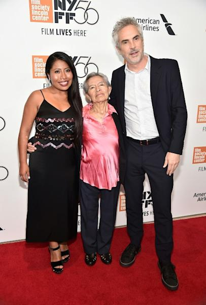 """""""Roma"""" star Yalitza Aparicio (L) posed with director Alfonso Cuaron (R) and his real-life nanny Libo Rodriguez -- played by Aparicio in the film -- at the premiere during the New York Film Festival in October 2018"""
