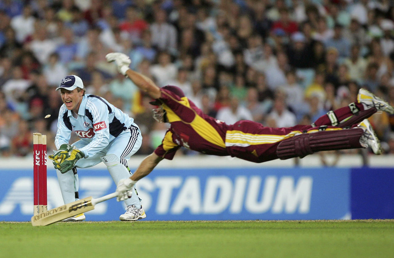 SYDNEY, AUSTRALIA - JANUARY 08:  A diving attempt by Lee Carseldine of the Bulls being run out by wicket keeper Brad Haddin of the Blues during the KFC Twenty20 Big Bash match between the New South Wales Blues and the Queensland Bulls at ANZ Stadium on January 8, 2008 in Sydney, Australia.  (Photo by Ezra Shaw/Getty Images)