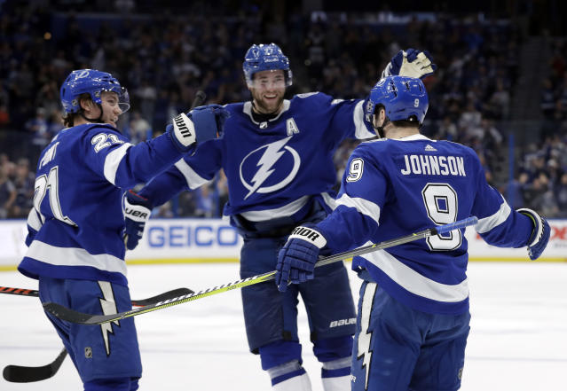 Tampa Bay Lightning center Tyler Johnson (9) celebrates his goal against the Toronto Maple Leafs with center Brayden Point (21) and defenseman Victor Hedman (77) during the second period of an NHL hockey game Thursday, Dec. 13, 2018, in Tampa, Fla. (AP Photo/Chris O'Meara)