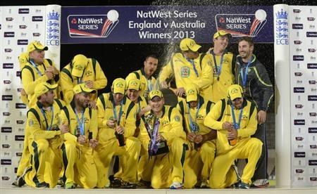 Australia's Michael Clarke (bottom C) holds the trophy after winning the fifth one-day international against England at the Rose Bowl in Southampton, England September 16, 2013. REUTERS/Philip Brown