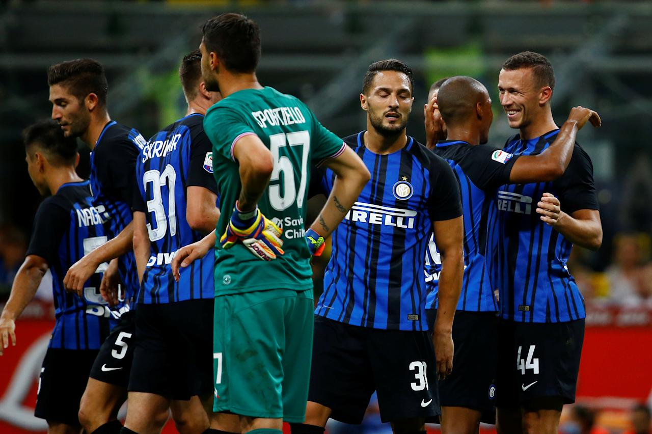 Soccer Football - Serie A - Inter Milan vs Fiorentina - Milan, Italy - August 20, 2017   Inter Milan's Ivan Perisic celebrates scoring their third goal with team mates   REUTERS/Stefano Rellandini