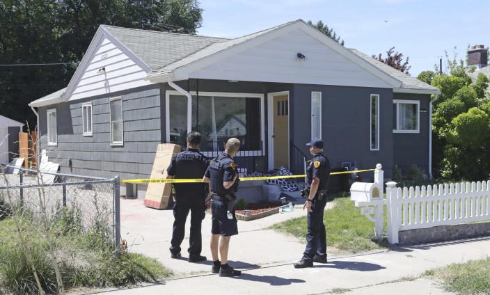 Police officers stand in front of the home of Ayoola A. Ajayi Friday, June 28, 2019, in Salt Lake City. Authorities are filing murder and kidnapping charges in the death of a Utah college student who disappeared 11 days ago. Salt Lake City police chief Mike Brown said 31-year-old Ajayi will be charged with aggravated murder, kidnaping and desecration of a body in the death of 23-year-old Mackenzie Lueck. (AP Photo/Rick Bowmer)