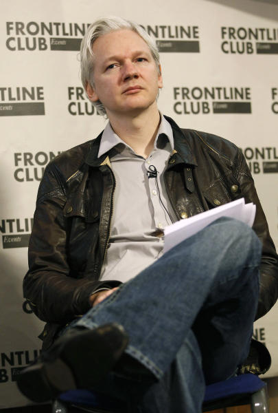 Julian Assange, founder of WikiLeaks listens during a press conference in London, Monday, Feb. 27, 2012. WikiLeaks said on Monday that it was publishing a massive trove of leaked emails from U.S. intelligence analysis firm Stratfor, shedding light on the inner workings of the Texas-based think tank. (AP Photo/Kirsty Wigglesworth)