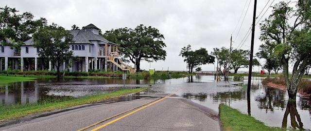 <p>Storm surge and heavy rains associated with Tropical Storm Cindy cause flooding in many areas of the Mississippi coast, including this area at the foot of Washington Avenue just off Front Beach in Ocean Springs, Miss., Wednesday, June 21, 2017. (Photo: Warren Kulo/The Mississippi Press via AP) </p>
