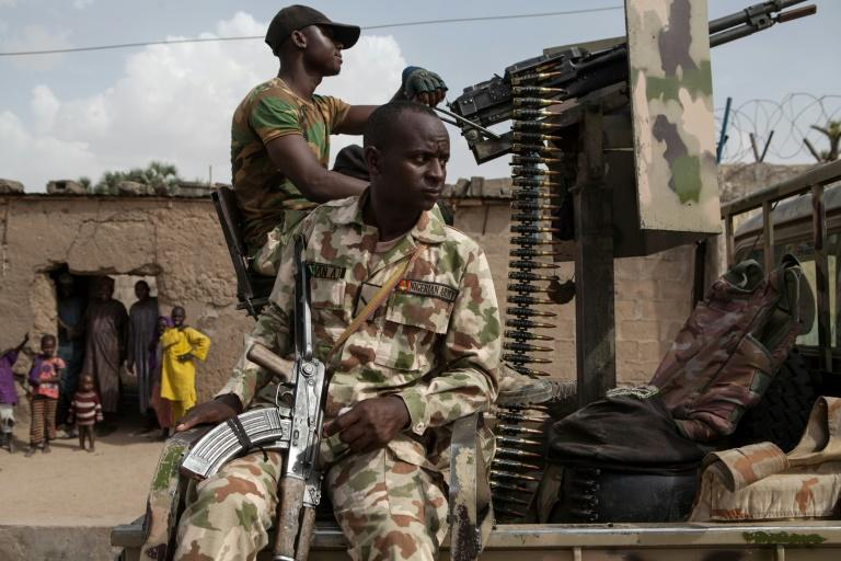 Nigerian soldiers on patrol in Banki to guard against infiltration or attack by Boko Haram insurgents