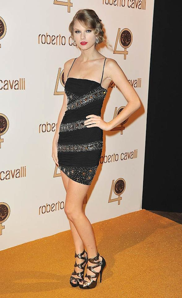 """Taylor Swift's becoming a regular red carpet hottie! The """"Mine"""" singer mingled with other A-listers in an embellished black mini, sexy, strappy heels, a wavy updo, and ruby red lips. Pascal Le Segretain/<a href=""""http://www.gettyimages.com/"""" target=""""new"""">GettyImages.com</a> - September 29, 2010"""