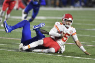 Kansas City Chiefs quarterback Patrick Mahomes, right, is sacked by Buffalo Bills' Mario Addison during the first half of an NFL football game, Monday, Oct. 19, 2020, in Orchard Park, N.Y. (AP Photo/Adrian Kraus)